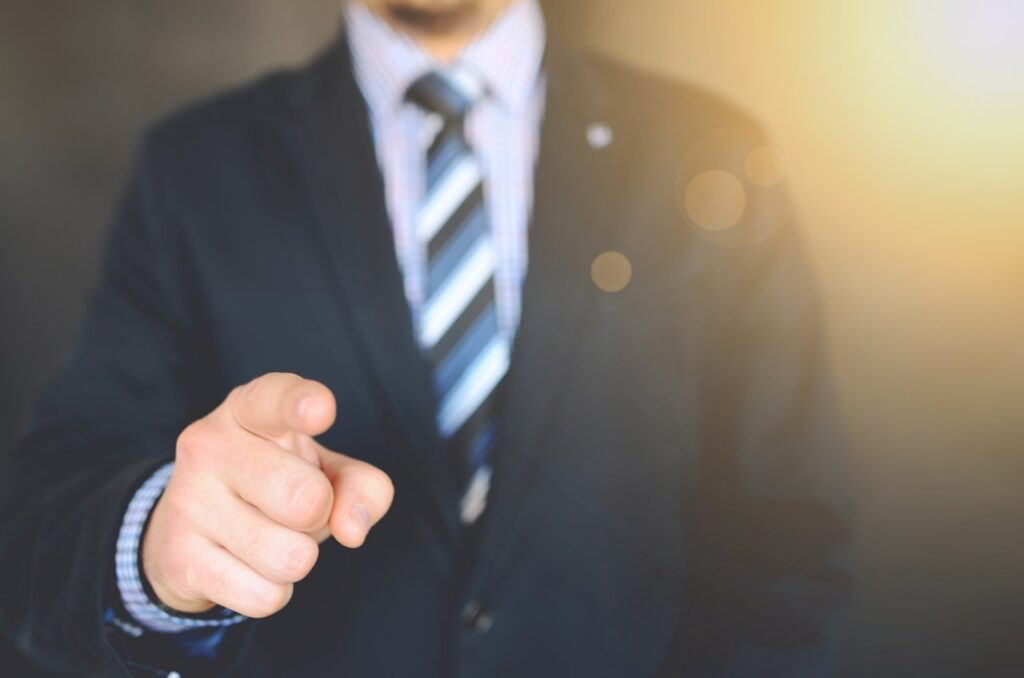 A finger pointing. Increasing autonomy can help in reducing Social Threats in Your Team