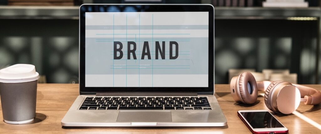A brand logo being designed on a lap top representing a personal branding activity.
