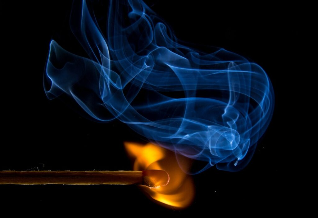 "A match sparking representing ""ignite talks"", a form of Lightning Talks"