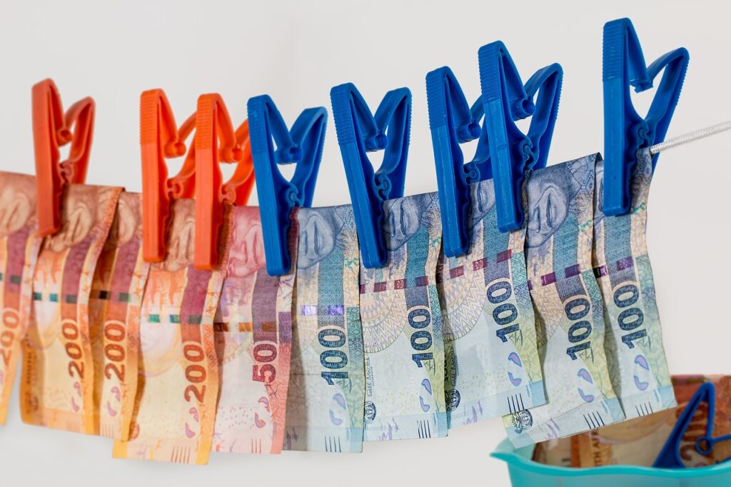 Money being dried on a clothesline. The symbolizes moneylaundering, and represents a possible negative outcome of Goal Setting Mistakes