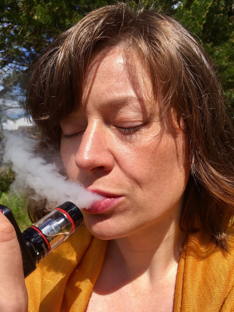A woman vaping. Our simple introduction to habits says it is easier to change than break them.