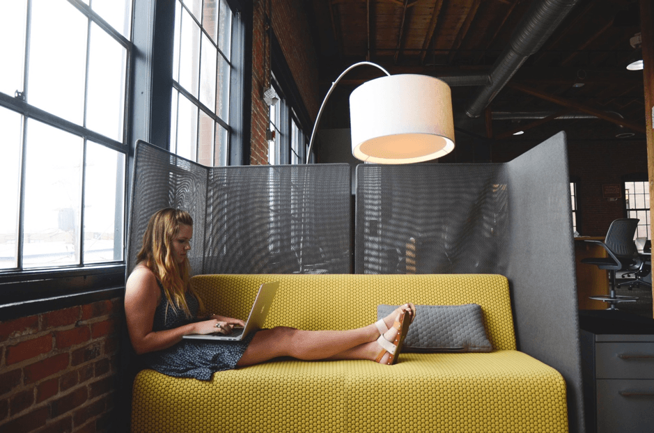 A woman in a shared workspace: The history of remote working has seen the rise of people working in different locations