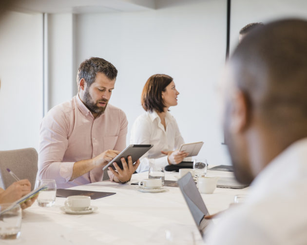 IT director in meeting with team