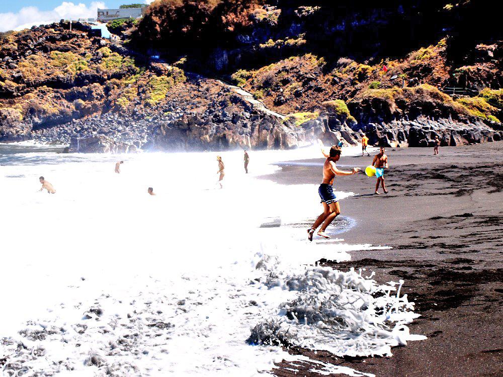 Fun in the Surf at Playa Bollullo