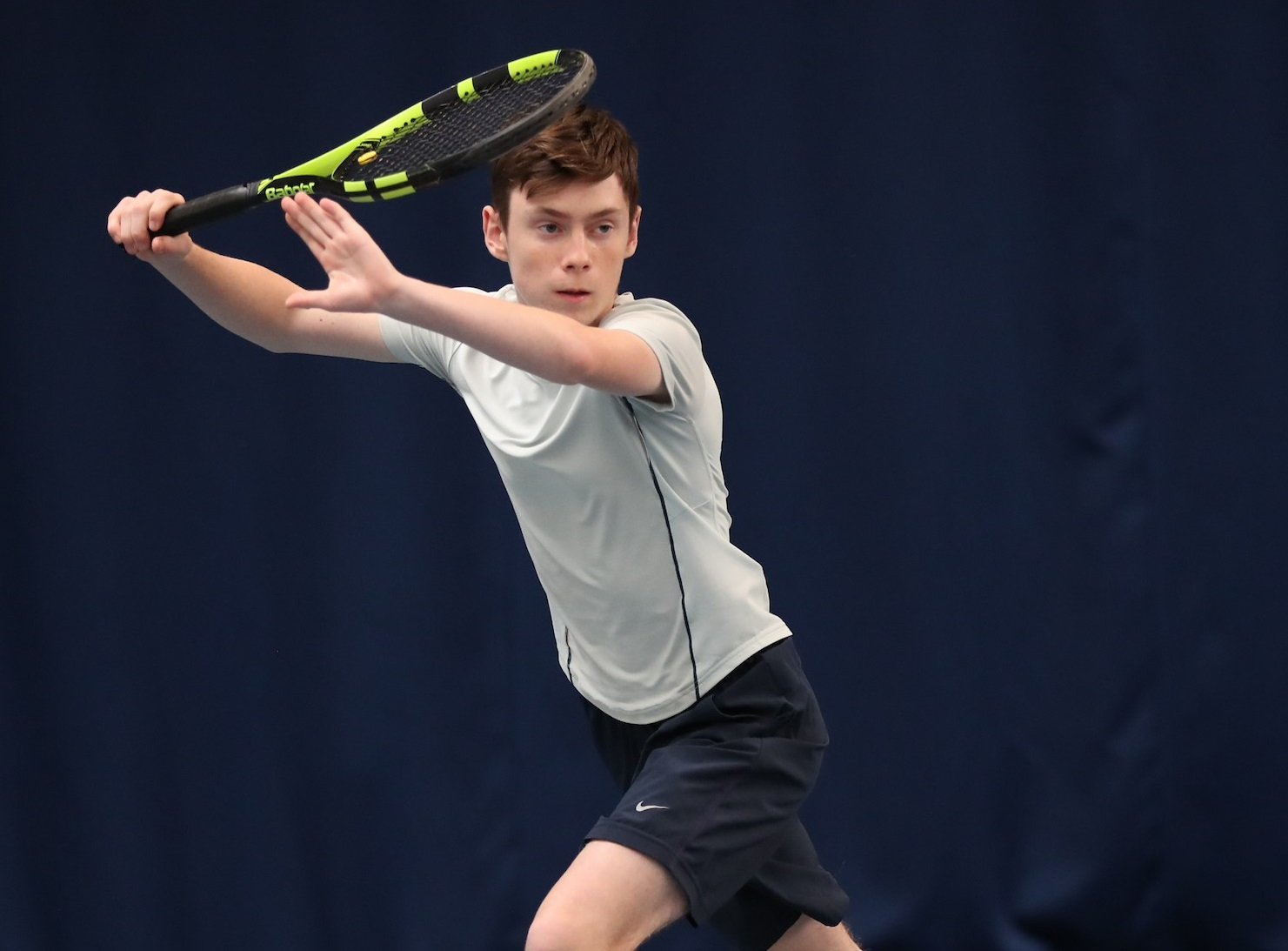 Luke Turnbull is pictured as he is about to hit the ball with his tennis racket