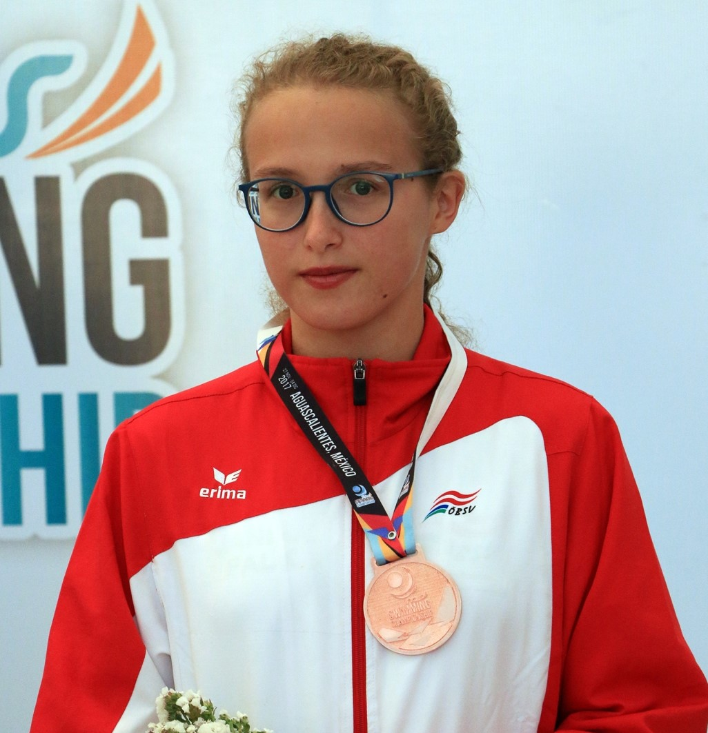 Janina Falk poses with her medal from the 2017 World Intellectual Impairment Sport Swimming World Championships
