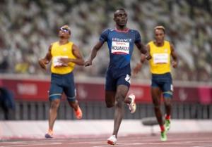 France's Charles-Antoine Kouakoa crosses the finish line to win Gold at the 400 meter