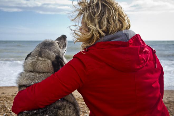 Jane snuggling with Magnus on Brighton beach