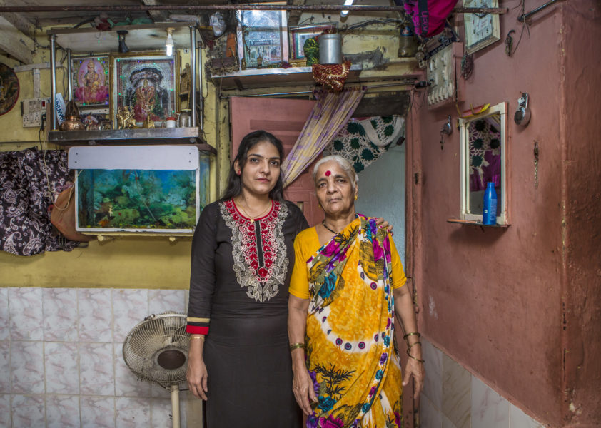 Aarti Naik changemaker in Generation Share, founder of the Sakhi School for Girls Education pictured with her mother  in their one-room slum in Muland, Mumbai.