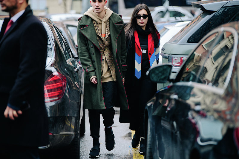 Marta Pozzan Filippo Bologni wearing matching sneakers during MFW.