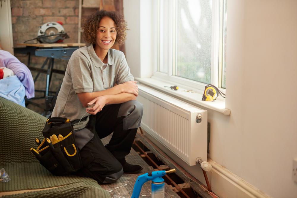 female heating installer plumber