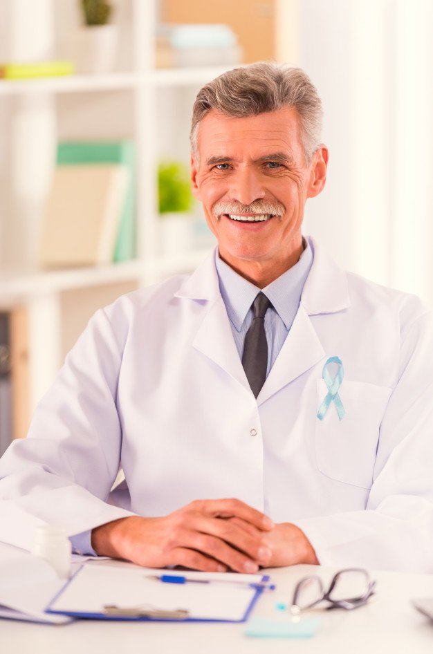 portrait-doctor-with-blue-ribbon-sitting-his-office_85574-5316.jpg
