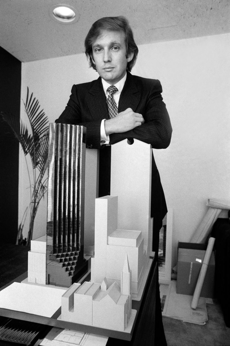Donald Trump in 1980, with a model of Trump Tower.Photograph by Don Hogan Charles / The New York Times / Redux