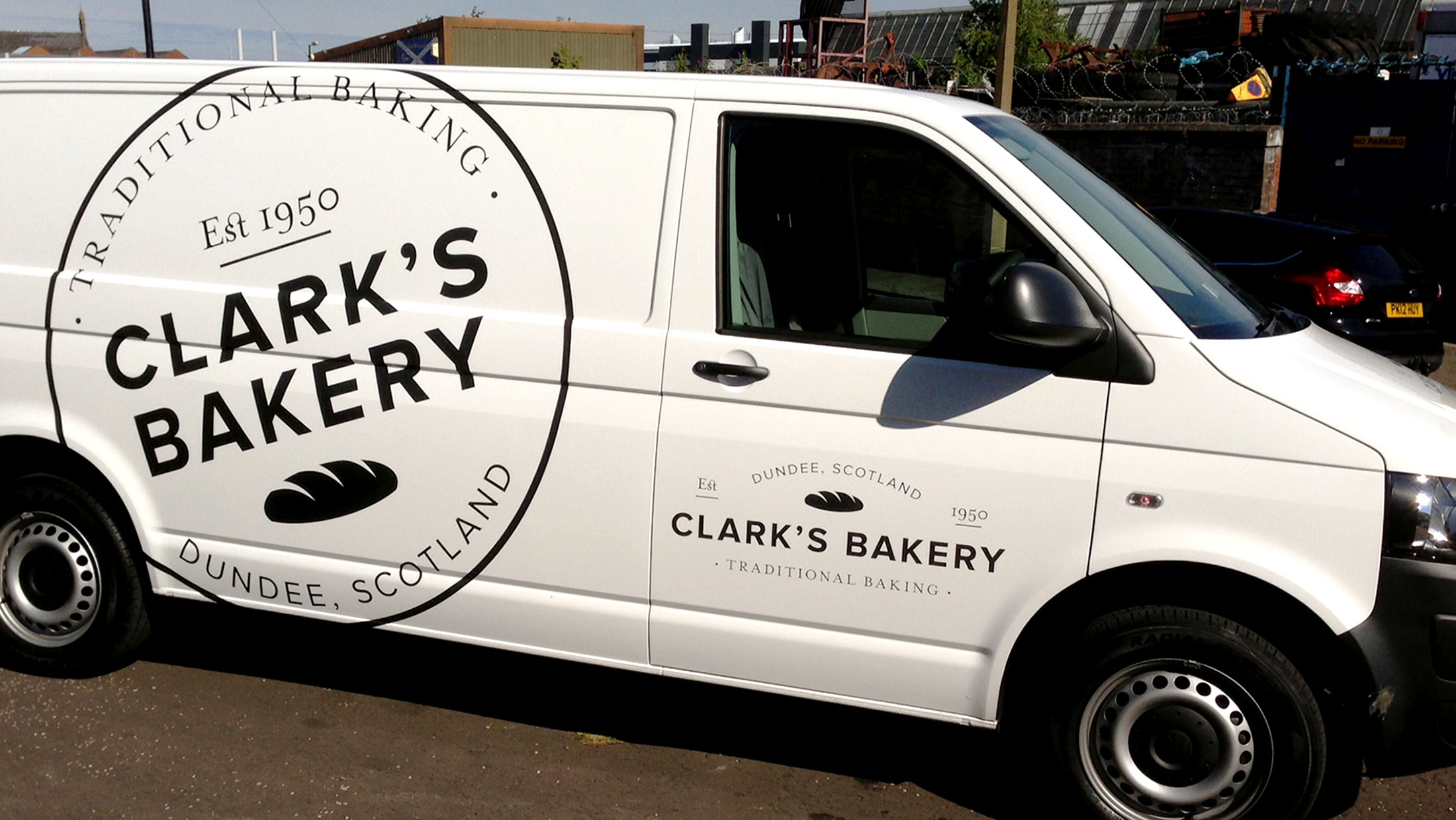 Clark's Bakery logo shown on the side of a white van