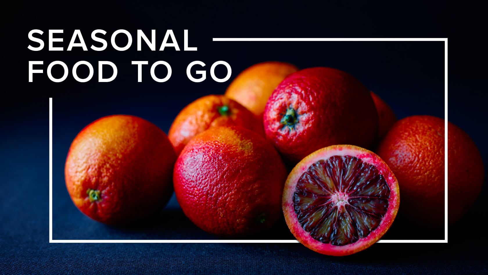Atmospheric photograph of oranges with the text Seasonal Food To Go