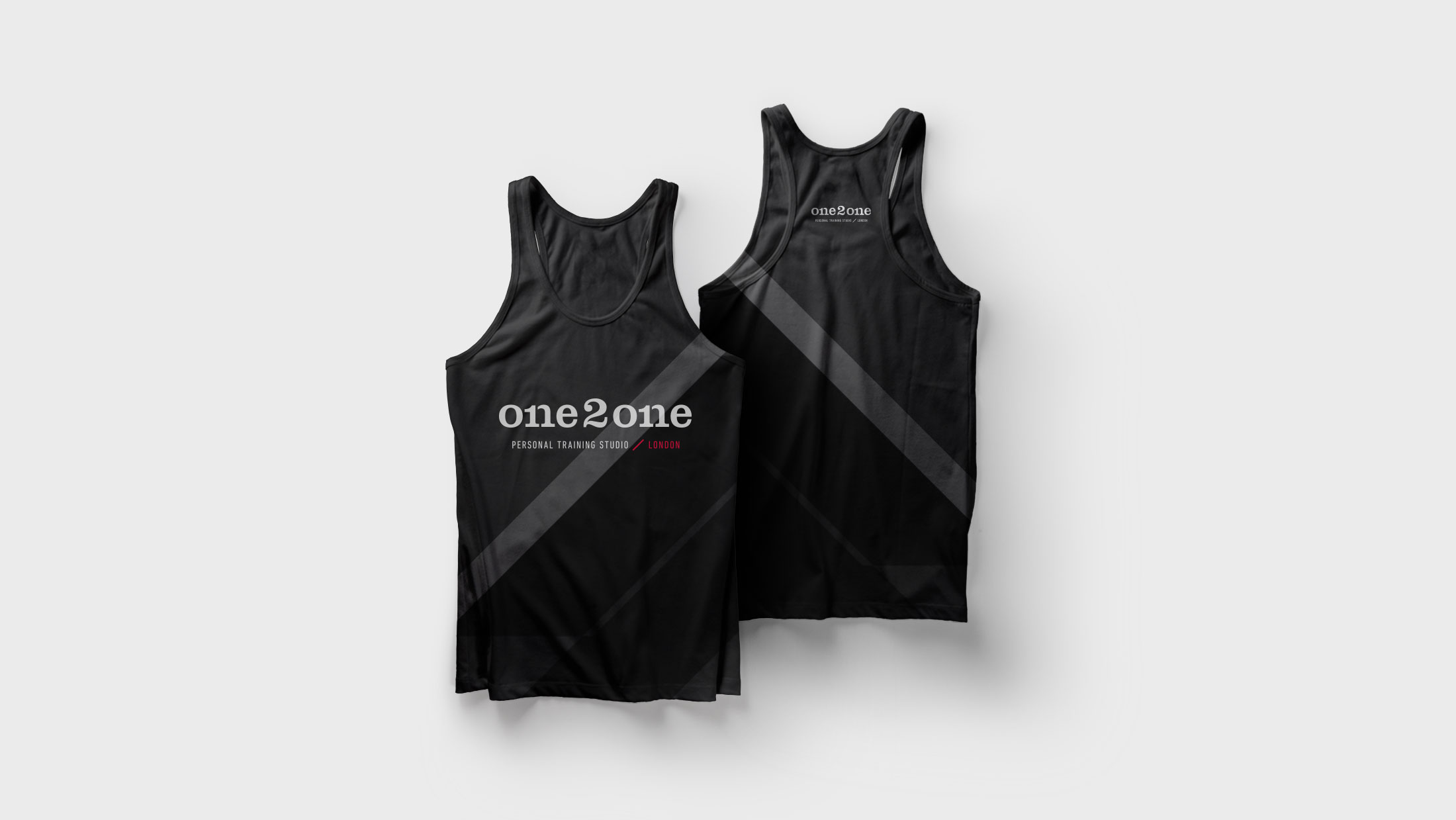 Apparel for One2One, a black tank top with diagonal line pattern