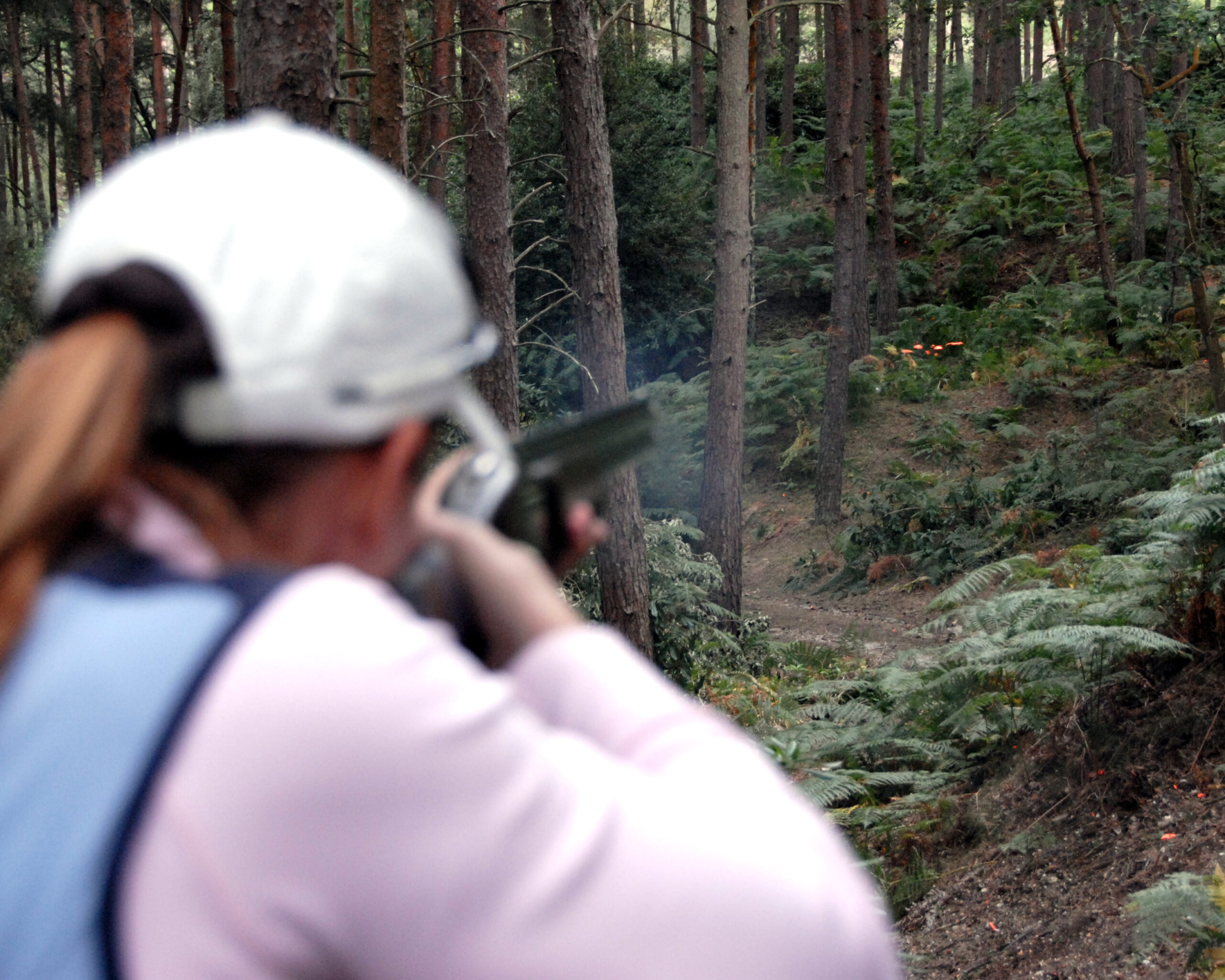 woman with a shotgun in forest | shotgun and firearms applications and renewals medical reports | Shotgun Medicals