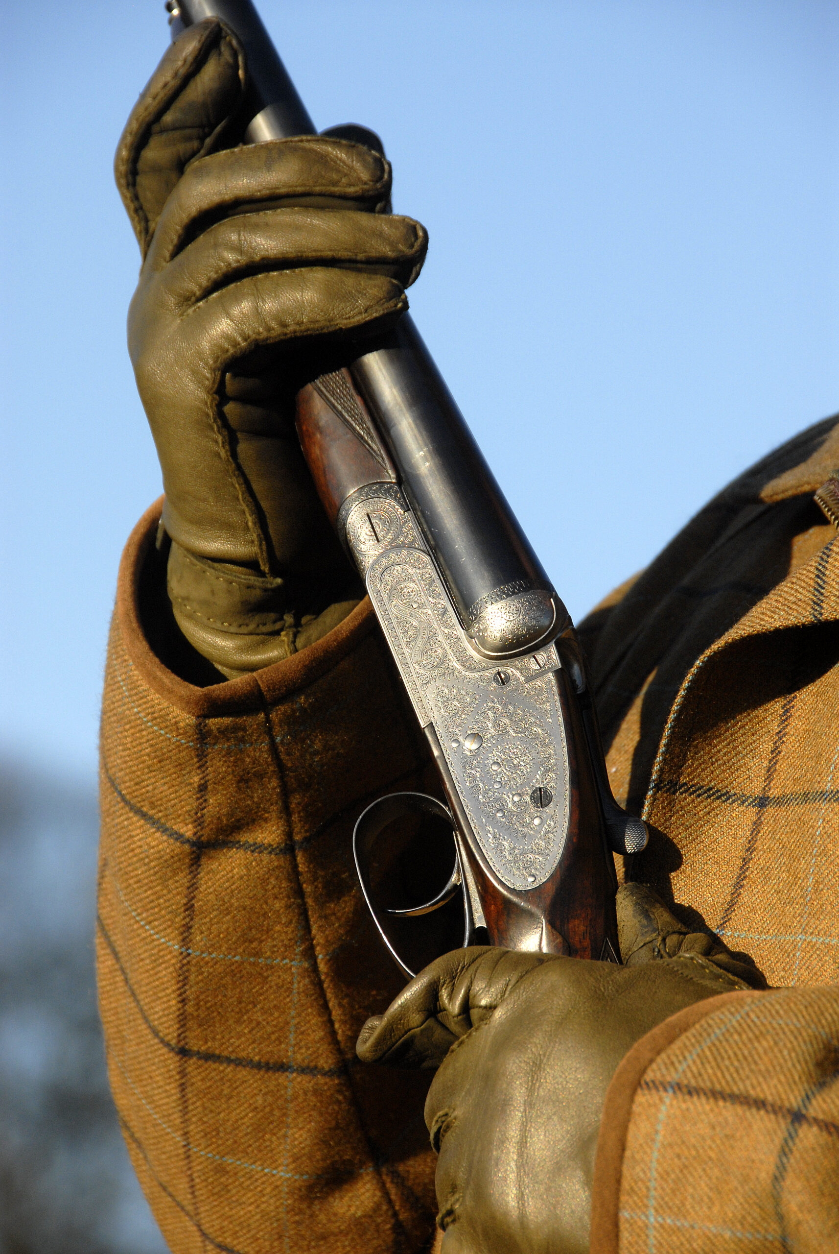 person with shotgun leather gloves | shotgun and firearms applications and renewals medical reports | Shotgun Medicals