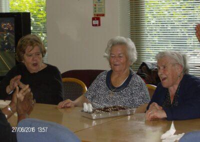 Older women singing happy birthday