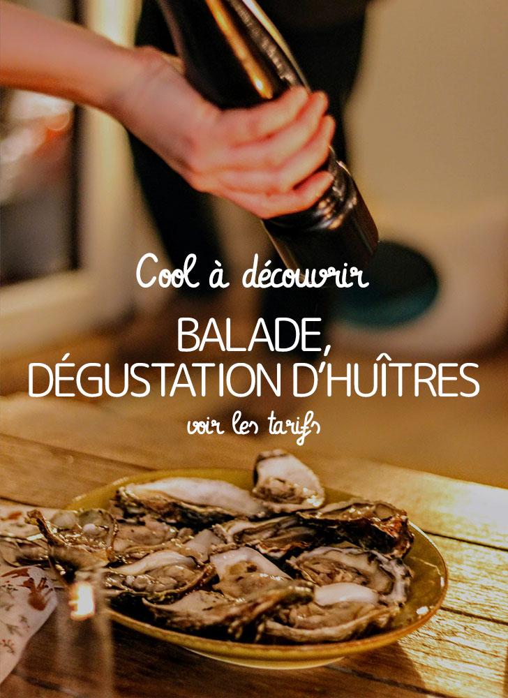 image d'une personne met du poivre noir au poivrier sur des huîtres à une table mange-debout après une balade en stand up paddle