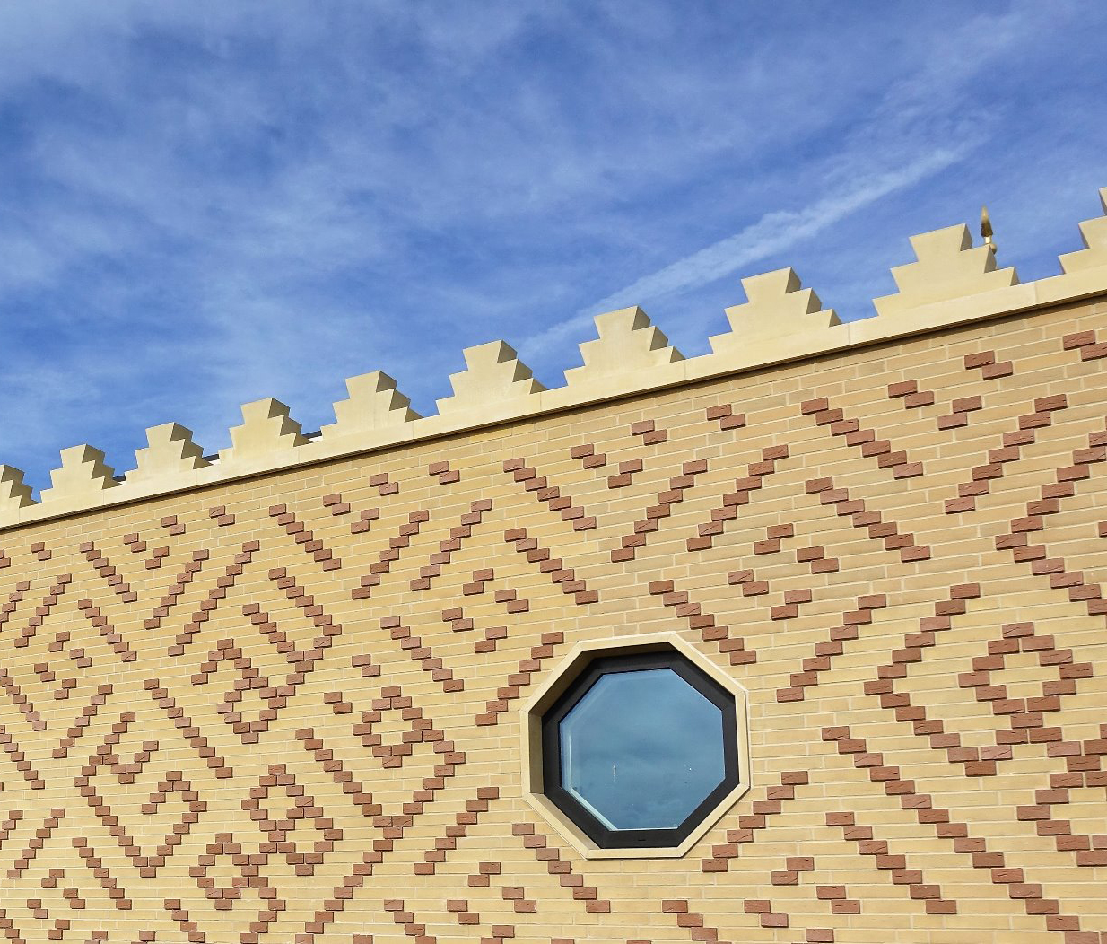Brick tiles and crenulations. The Cambridge Mosque by Marks Barfield Architects
