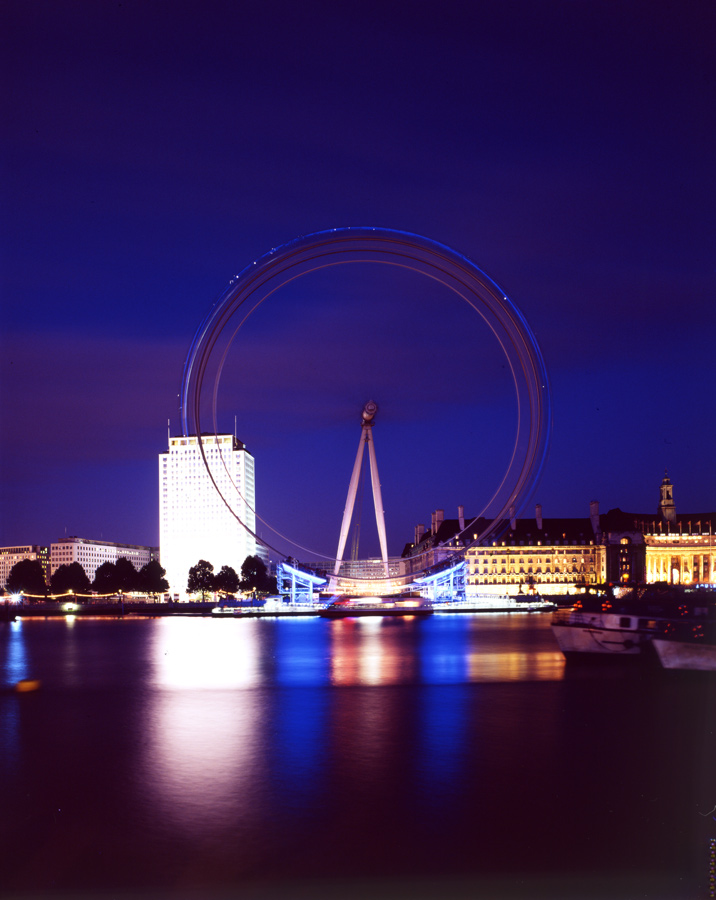 View from Victoria Embankment at dusk. The London Eye by Marks Barfield Architects