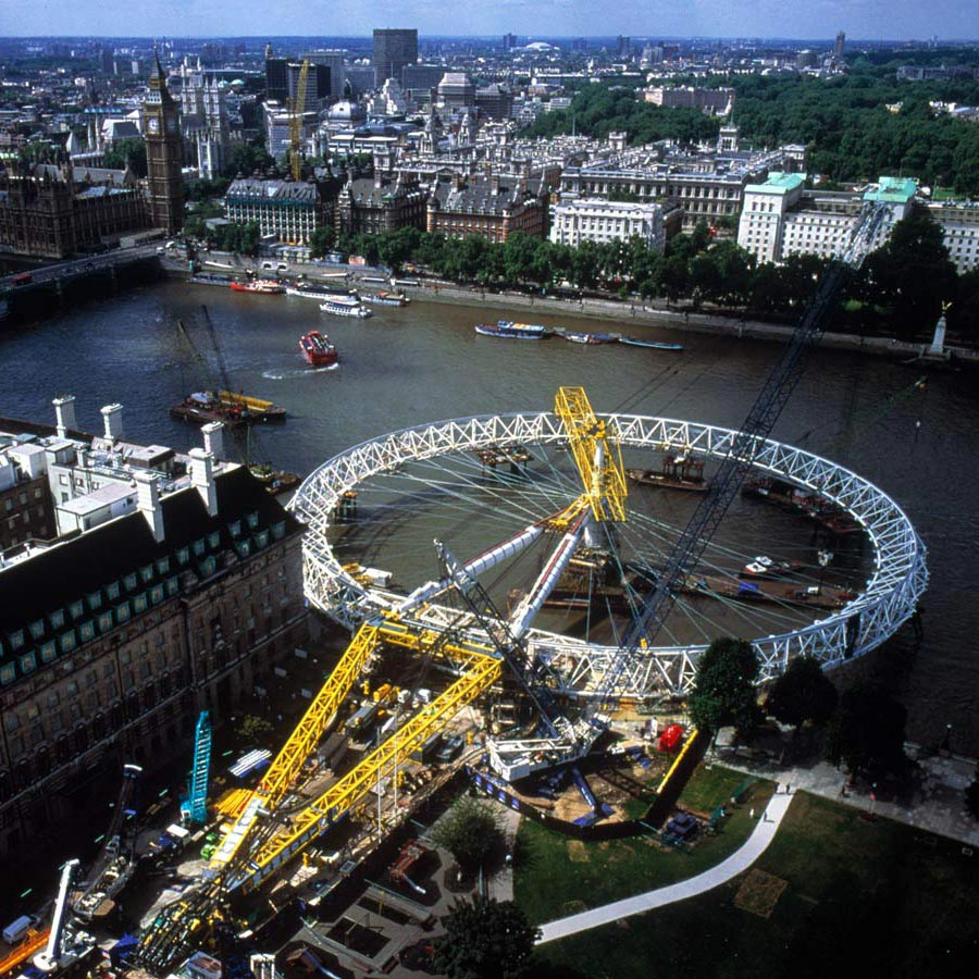Construction photo by Nick Wood - Wheel laying on the River Thames - The London Eye by Marks Barfield Architects