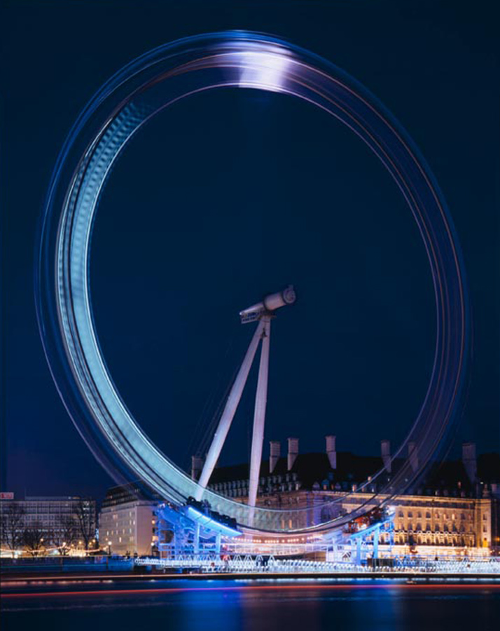 From Victoria Embankment at dusk, as the lighting system is tested. The London Eye by Marks Barfield Architects