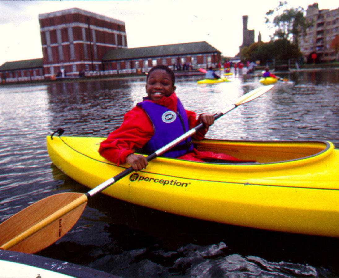 Kid in a canoe - Stoke Newington Watersports Centre by Marks Barfield Architects