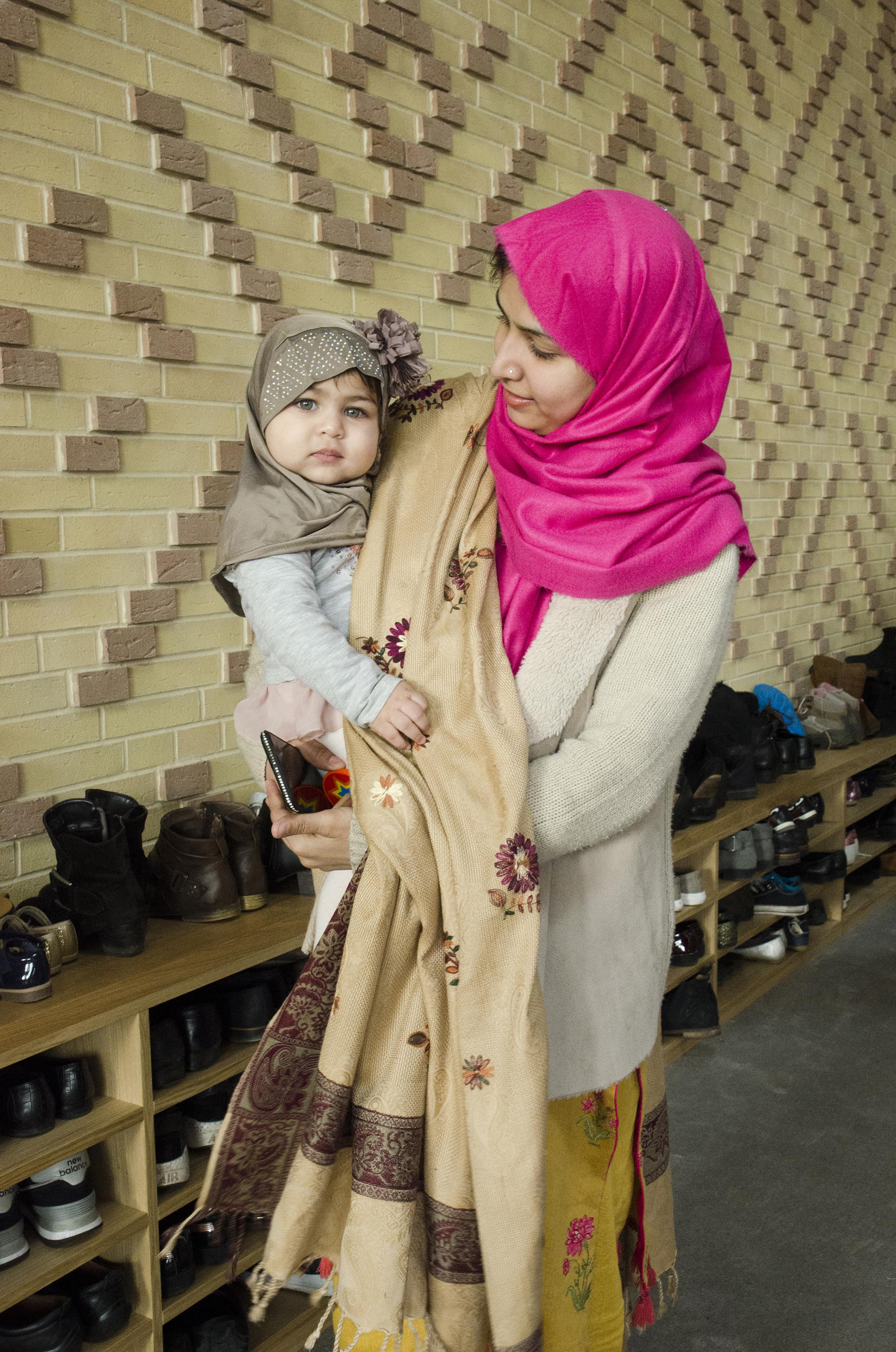 Cambridge Mosque - A mother & child in the Atrium- by Marks Barfield Architects, photo by Julia C. Johnson