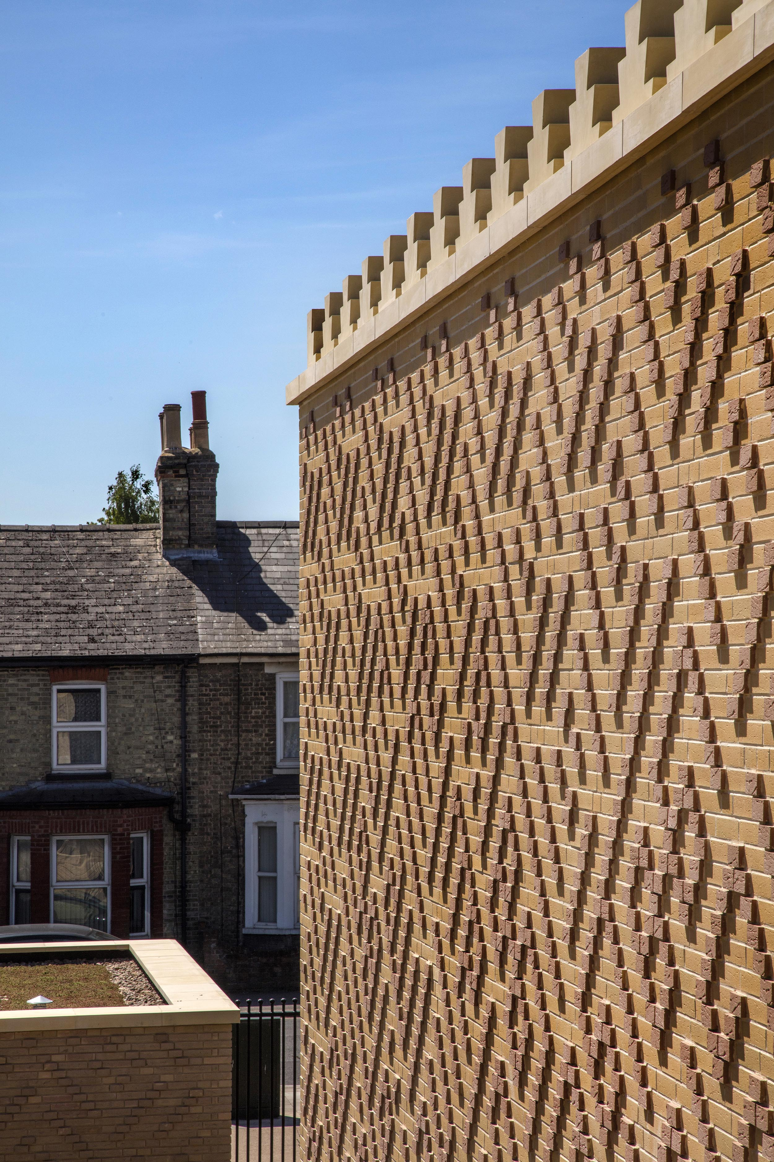Cambridge Mosque Brick tile cladding & crenulations by Marks Barfield architects, photography by Morley von Sternberg