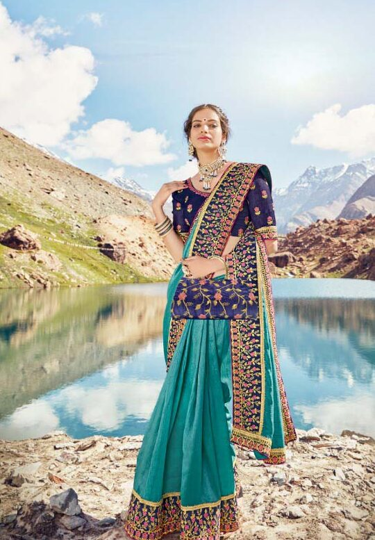 Best embroidered sky-blue vichitra silk saree with heavy lace.