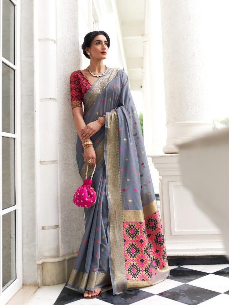 Best georgette gray color handloom weaving saree with a red blouse.