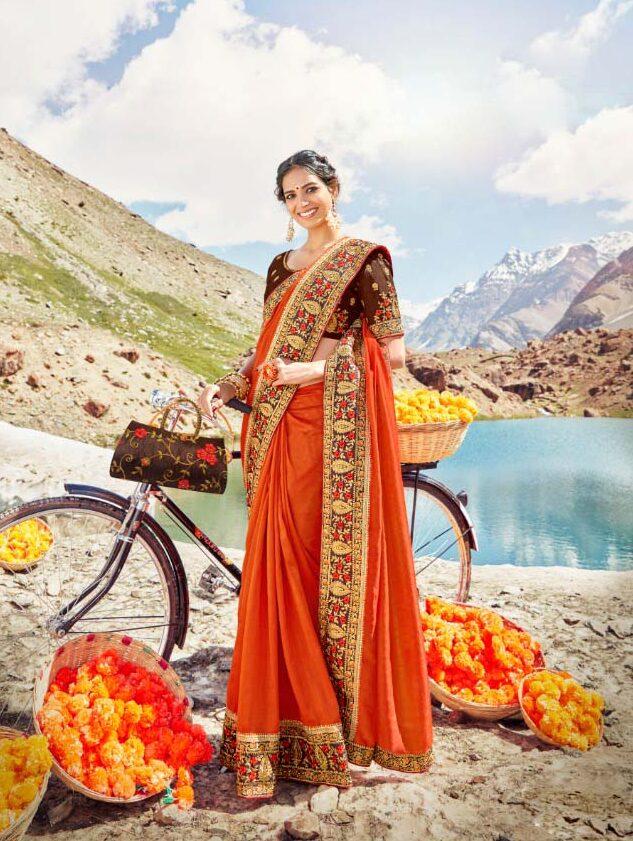 New trend designer orange color silk saree with heavy lace.