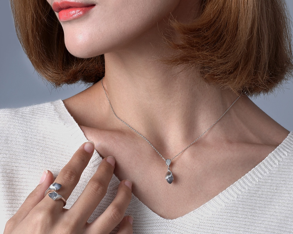 Fei Liu's Magnolia collection: silver necklace and ring with cubic zirconia and cat's eye.
