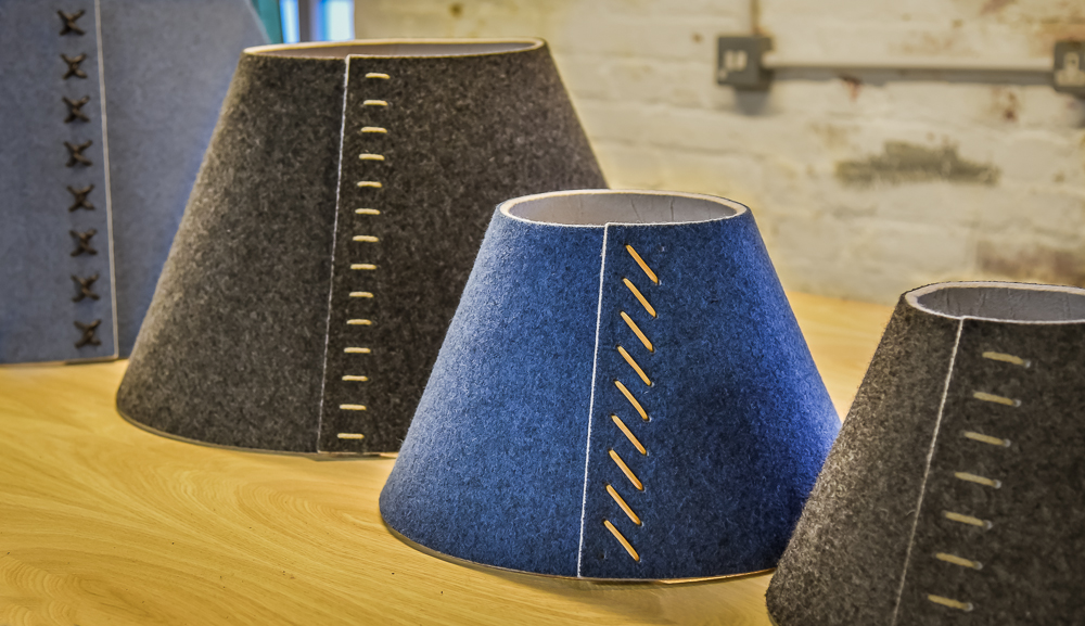 Grey, blue and dark grey, Delta - a Spitfire Furniture product as an acoustic lighting solutions for desks, offices or spaces. PET lighting, eco-friendly and acoustic