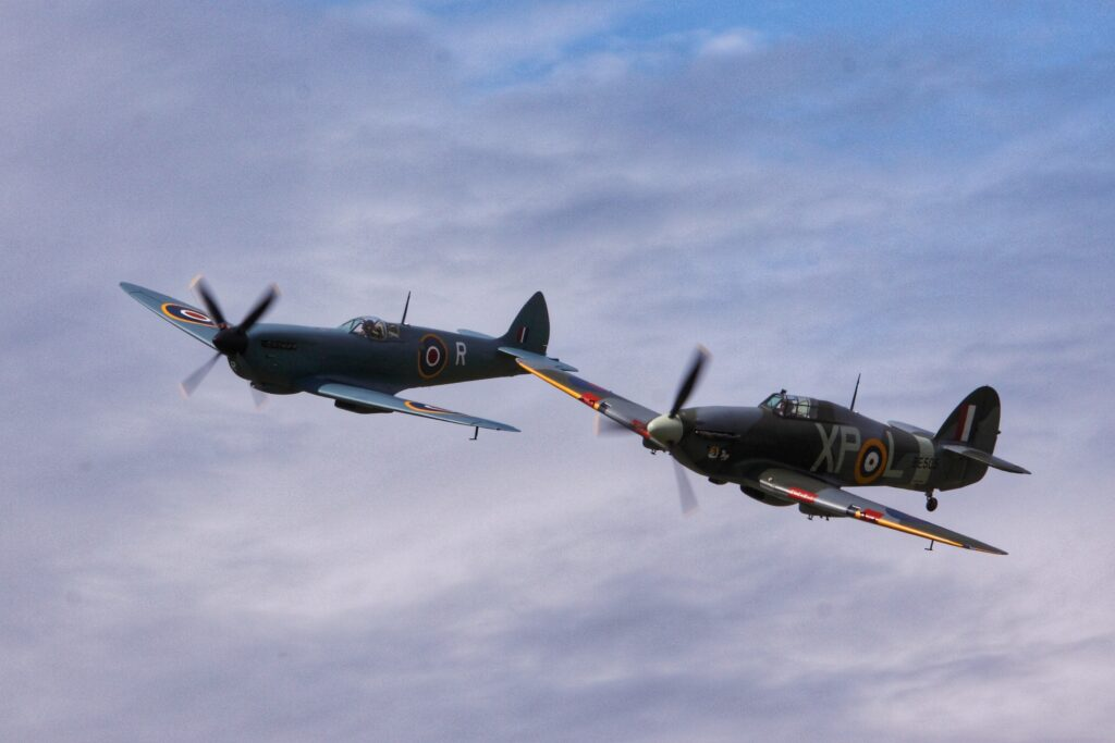 Spitfire and Lancaster bombers fly in the sky as RAF planes