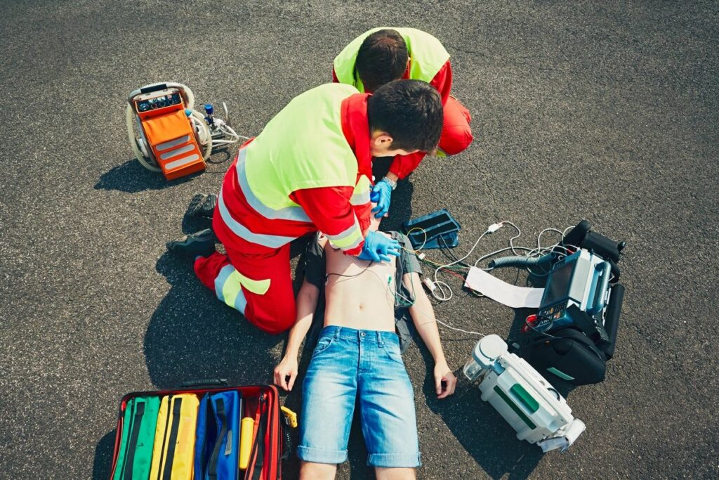 EMS doing CPR on child