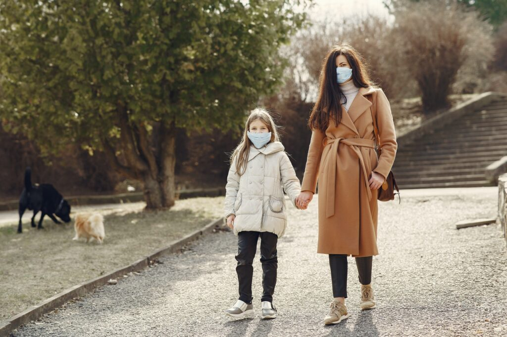 Mother & daughter walking with masks on