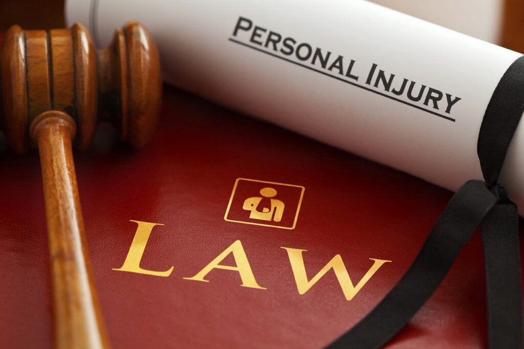 Personal Injury Lawyer documents, book, and gavel
