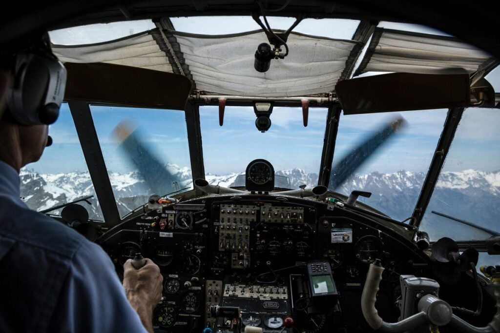 Pilot looking out the front windows of an airplane