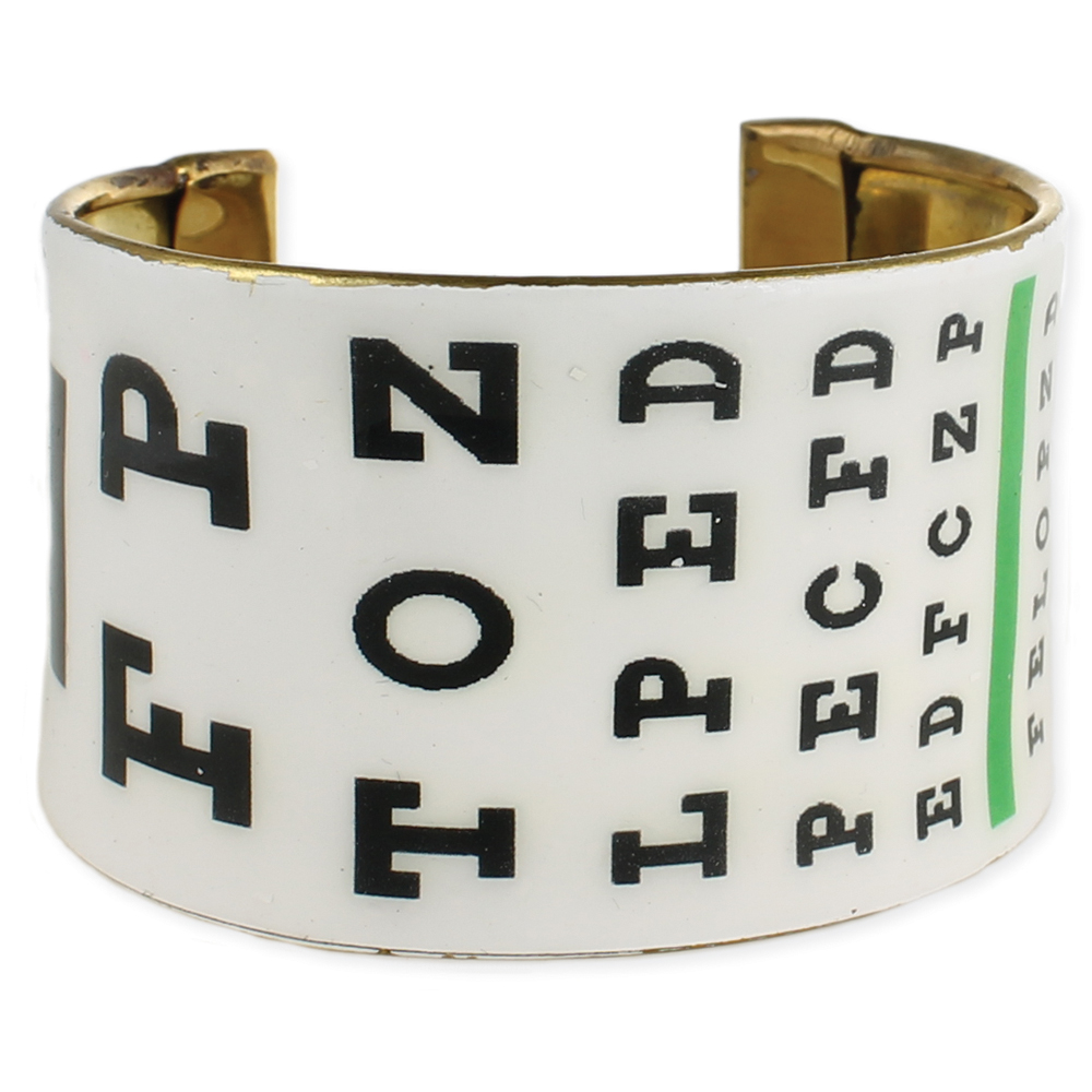 Eye chart cuff bracelet. White bracelet with black letters just like an eye chart. Gold-plated on the inside.
