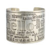 Silver statement cuff bracelet with the word hello in English and several other languages.