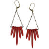 Bohemian statement earrings. Red howlite beads are suspended from a brass chain and ear wires.
