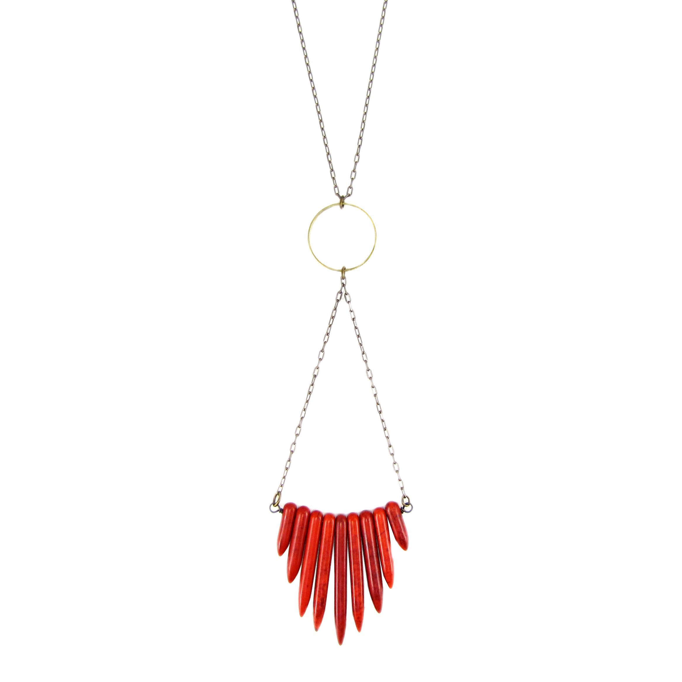 Red Howlite Bead Statement Necklace. Features red howlite beads hanging from a brass circle on a brass chain.