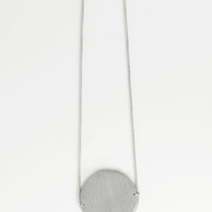 long silver necklace with silver medallion