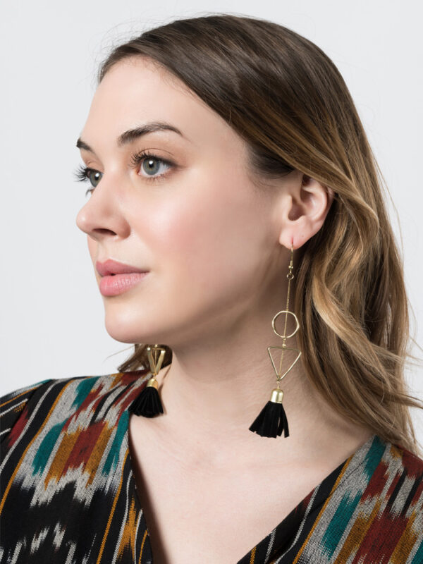 model wearing suede tassel earrings in black