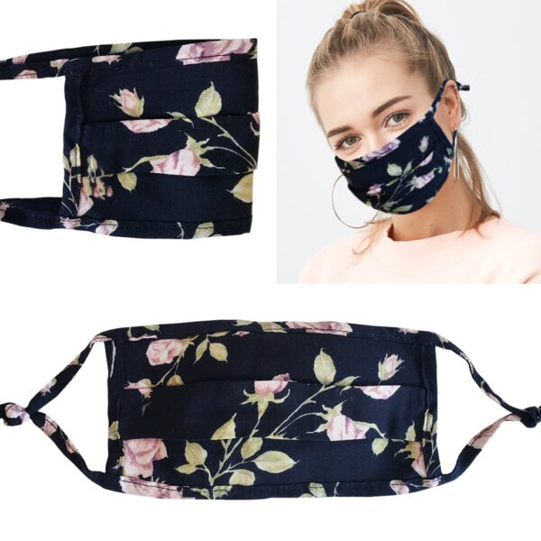 Model wearing a black floral mask with filter pocket. Filter included. Adjustable ear straps.