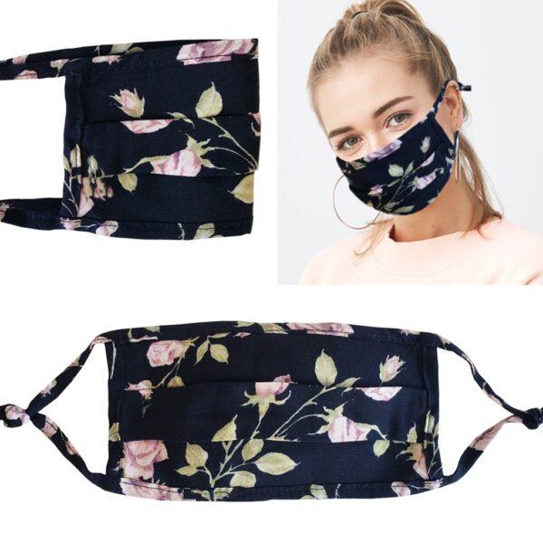 Model wearing a black floral mask with filter pocket. Filter included. Adjustable ear straps.