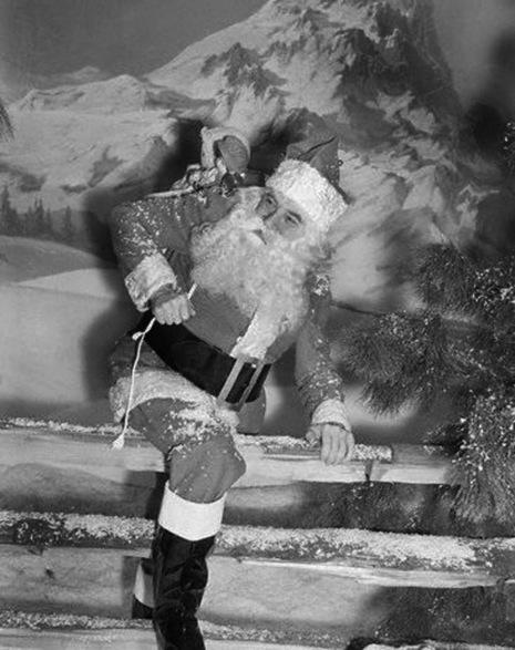 Bela Lugosi as Santa Climbing Over Fence